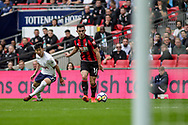 Heung Min Son of Tottenham Hotspur chases down Lewis Cook of AFC Bournemouth.<br /> Premier league match, Tottenham Hotspur v AFC Bournemouth at Wembley Stadium in London on Saturday 14th October 2017.<br /> pic by Kieran Clarke, Andrew Orchard sports photography.