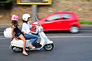 Rome, Italy Women speed on a scooter