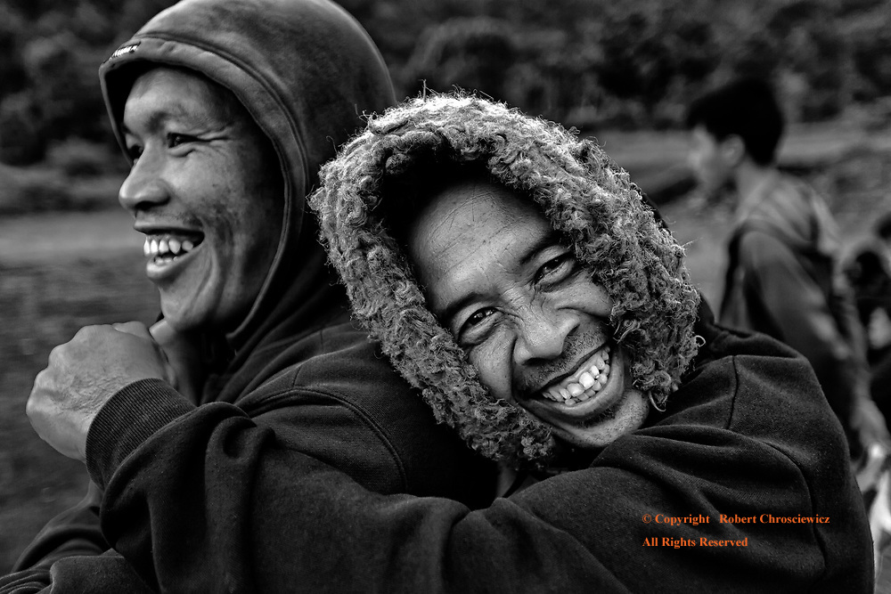Enthralled (B&W): A man enthusiastically embraces his partner with pure joy; on a cold day beside the volcanic Batur Lake, Bali Indonesia.
