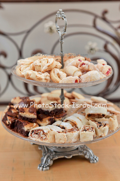 Assortment of biscuits on a layered serving dish