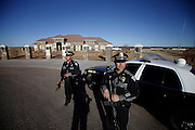 pvc011514d/1-14-14/asec.  Two New Mexico State Police officers stand guard holding semi-automatic rifles outside the home of Mason Campbell, the alleged shooter at Berrendo Middle School in Roswell, N.M., photographed Tuesday Jan. 14, 2014.  According to the New Mexico State police, Campbell shot two students in the school's gymnasium before classes began.  The two injured students were airlifted to a Lubbock, TX hospital.  (Pat Vasquez-Cunningham/Journal)