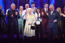 Queen Elizabeth II and the Prince of Wales with Sir Tom Jones (left) and other performers on stage at the Royal Albert Hall in London during a star-studded concert to celebrate the Queen's 92nd birthday.