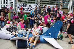 London, UK. 29 July, 2019. Activists from Reclaim the Power, All African Women's Group, Docs Not Cops, Lesbians and Gays Support the Migrants and other groups protest alongside a model of an aircraft used for deportation flights outside the Home Office to demand an end to the Government's 'hostile environment' policies.