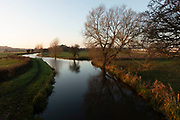 Evening view along the Trent and Mersey Canal at Rugeley, Staffordshire, United Kingdom.