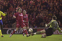 Photo. Glyn Thomas.<br /> Middlesbrough v Arsenal. Carling Cup semi final second leg. <br /> Riverside Stadium, Middlesbrough. 03/02/2004.<br /> Boro's Bolo Zenden (L) puts his side a goal in front as he sends the ball over the diving Arsenal keeper Graham Stack.