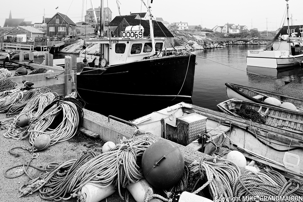 Fishing boats and gear in village<br />Peggy's Cove <br />Nova Scotia<br />Canada