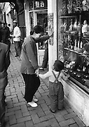 C012-25_Tom Hutchins_Mother and son in front of shop. Wang Fu Chin, Peking, China 1956 A2.tif