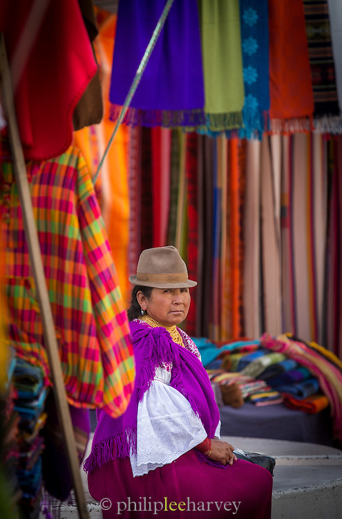 Portrait of market stall holder selling coloured rugs., Otavalo Market , Ecuador, South America