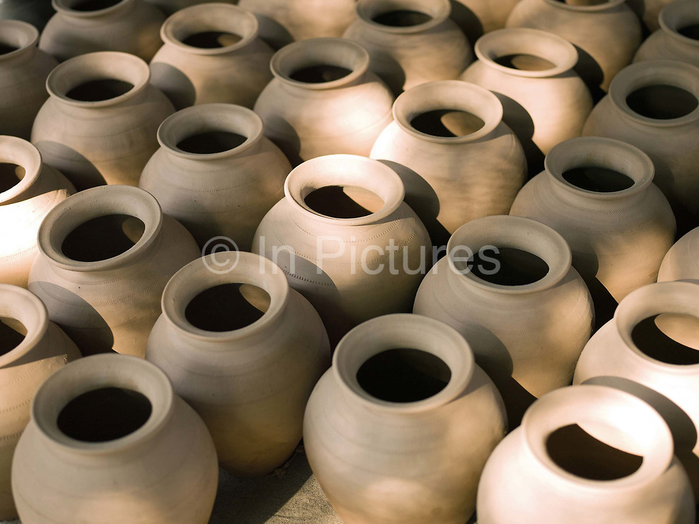 Handmade pots drying in the specialist pottery village of Ban Chan, 3 km from the heritage city of Luang Prabang, where age old traditions and methods continue to be used for producing pottery both for local use and commercial markets