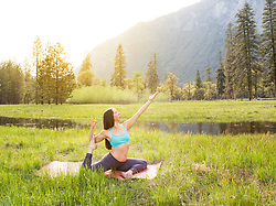 May 4, 2017 - Woman practicing yoga pose by lake in Yosemite National Park, California, USA (Credit Image: © Brian Holstein/Image Source via ZUMA Press)