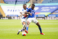 LEICESTER, ENGLAND - JULY 04: Wilfred Ndidi of Leicester City holds off Jordan Ayew of Crystal Palace during the Premier League match between Leicester City and Crystal Palace at The King Power Stadium on July 4, 2020 in Leicester, United Kingdom. Football Stadiums around Europe remain empty due to the Coronavirus Pandemic as Government social distancing laws prohibit fans inside venues resulting in all fixtures being played behind closed doors. (Photo by MB Media)