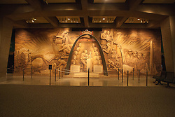 18 October 2010: A wall displays a graphic relief that shows various monuments and buildings with respect to height and also laments the designer of the gateway arch.  Gateway Westward Museum,St. Louis Missouri