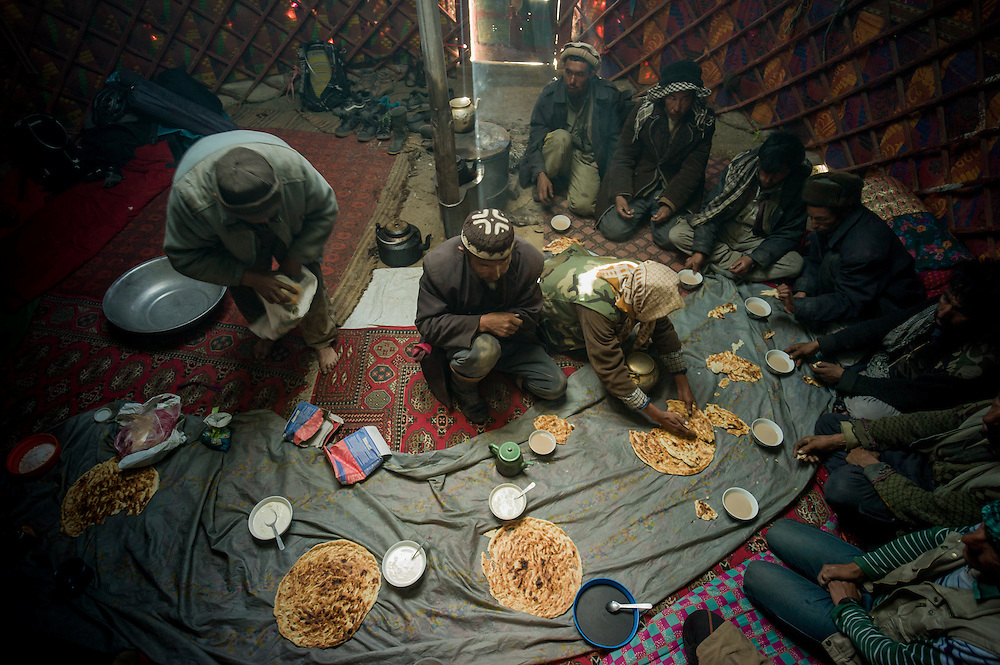 A welcoming afternoon tea with the chief of the settlement, Kyrgyz controlled Great Pamir. On arrival and being invited in to the yurt out of the wind, a rug was unrolled on which the flat bread, tea and yak yoghurt served.