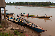 Cayucos with products for trade in the riverbed of the Madre de Dios River, near the town of Boca Colorado, Peru. In the interior of the Amazon jungle there are many camps for the extraction of gold.