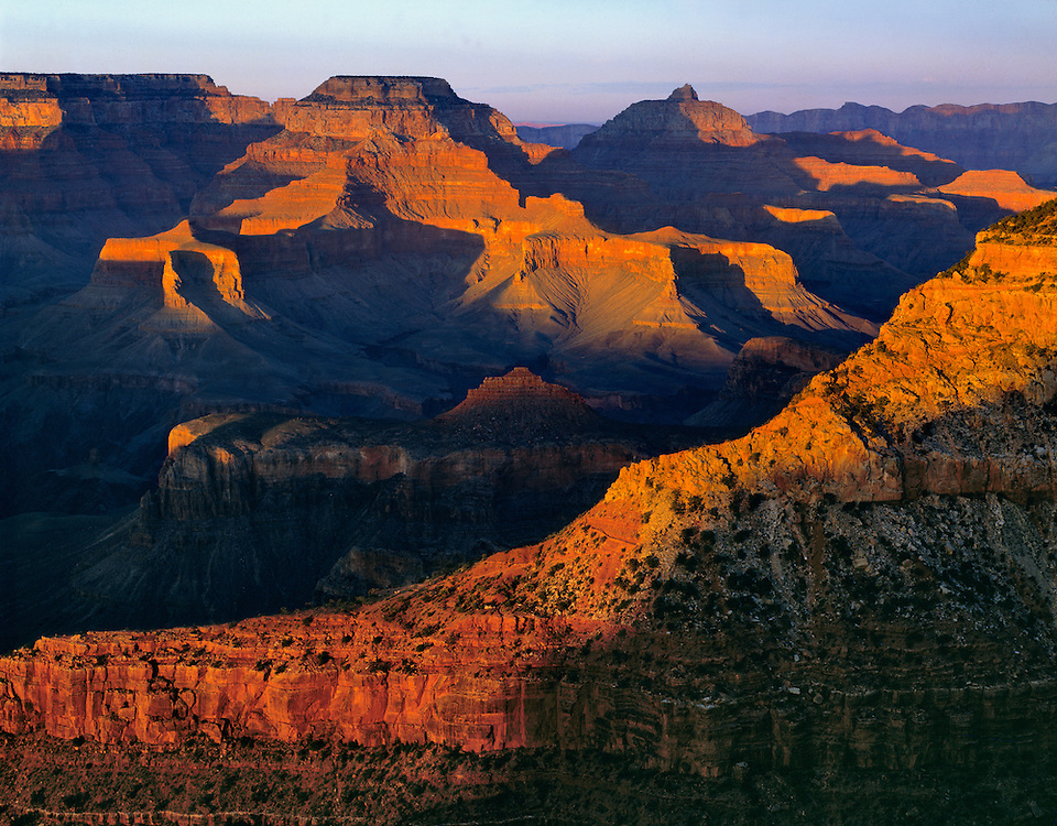 A World Heritage Site, just the tops of the mesas are lit at sunset at the Grand Canyon National Park, Arizona.