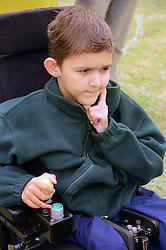Young wheelchair user at Mini games sports event held at Stoke Mandeville Stadium,