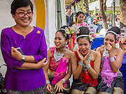 19 APRIl 2014 - BANGKOK, THAILAND:  The director of a girls' performance troupe with some of the performers backstage at the Rattanakosin Festival in Bangkok. Rattanakosin is the name of the man made island that is the heart of the old city. Bangkok was formally founded as the capital of Siam (now Thailand) on 21 April 1782 by King Rama I, founder of the Chakri Dynasty. Bhumibol Adulyadej, the current King of Thailand, is Rama IX, the ninth King of the Chakri Dynasty. The Thai Ministry of Culture organized the Rattanakosin Festival on Sanam Luang, the royal parade ground in the heart of the old part of Bangkok, to celebrate the city's 232nd anniversary.   PHOTO BY JACK KURTZ