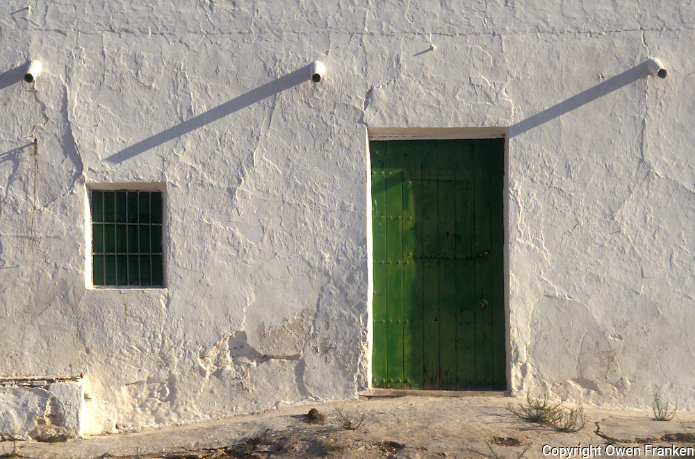 whitewashed stucco wall in Almeria, Spain - Photograph by Owen Franken
