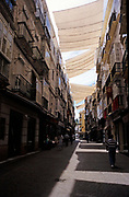 Large sheets used to provide shade to city centre street in Cadiz, Spain