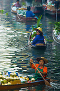 17 JANUARY 2013 - DAMNOEN SADUAK, RATCHABURI, THAILAND: Vendors in the Damnoen Saduak (also spelled Damnoensaduak) floating market wait for tourists to arrive. The floating market in Damnoen Saduak is one of the best known tourist attractions in Thailand. The canal was dug in the 1860's to connect to provincial towns south of Bangkok. At the time it was the straightest, longest canal in Thailand. Thousands of tourists, both foreign and Thai, visit Damnoen Saduak to see the floating market and experience canal life.     PHOTO BY JACK KURTZ