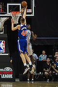 Kristaps Porzingis #46 of the New York Knicks drives to the basket against the San Antonio Spurs during an NBA Summer League game in Las Vegas, Nevada on July 11, 2015. (Cooper Neill for The New York Times)