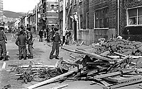 Soldiers at scene of Provisional IRA bombing of Hastings Street RUC Station, Belfast, N Ireland, 10th June 1971, 197106100224<br /> <br /> Copyright Image from Victor Patterson, 54 Dorchester Park, <br /> Belfast, UK, BT9 6RJ<br /> <br /> t1: +44 28 9066 1296 (from Rep of Ireland 048 9066 1296)<br /> t2: +44 28 9002 2446 (from Rep of Ireland 048 9002 2446)<br /> m: +44 7802 353836<br /> <br /> e1: victorpatterson@me.com<br /> e2: victorpatterson@gmail.com<br /> www.victorpatterson.com<br /> <br /> Please see my Terms and Conditions of Use at www.victorpatterson.com. It is IMPORTANT that you familiarise yourself with them.<br /> <br /> Images used on the Internet must be visibly watermarked i.e. © Victor Patterson<br /> within the body of the image and copyright metadata must not be deleted. Images <br /> used on the Internet have a size restriction of 4kbs and will be chargeable at current<br />  NUJ rates unless agreed otherwise.<br /> <br /> This image is only available for the use of the download recipient i.e. television station, newspaper, magazine, book publisher, etc, and must not be passed on to any third <br /> party. It is also downloaded on condition that each and every usage is notified within 7 days to victorpatterson@me.com<br /> <br /> The right of Victor Patterson to be identified as the author is asserted in accordance with The Copyright Designs And Patents Act (1988).