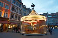 Carousel in the Christmas market at dusk - Strasbourg France