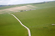 Road crossing rolling chalk landscape viewed from Beachy Head, East Sussex, England