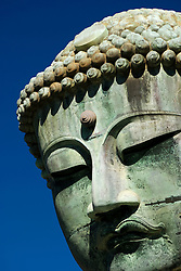 Detail of head of famous Buddha Statue at Kotokuin temple in Kamakura Japan