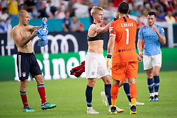 July 28, 2018 - Miami Gardens, FL, U.S. - MIAMI GARDENS, FL - JULY 28: Manchester City's Oleksandr Zinchenko (center) high fives Manchester City's goalkeeper Claudio Bravo (1) after exchanging jerseys with Bayern Munich's Arjen Robben (left) after the International Champions Cup game between FC Bayern Munich and Manchester City FC on July 28, 2018 at the Hard Rock Stadium in Miami Gardens, Florida. (Photo by Doug Murray/Icon Sportswire) (Credit Image: © Doug Murray/Icon SMI via ZUMA Press)