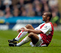 Fotball<br /> Photo. Jed Wee, Digitalsport<br /> NORWAY ONLY<br /> Newcastle United v Arsenal, FA Barclaycard Premiership, St James' Park, Newcastle. 11/04/2004.<br /> Arsenal's Ashley Cole grimaces at his ankle injury that forces him off the field.