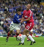 Picture: Henry Browne.<br />Date: 04/10/2003.<br />Portsmouth v Charlton Athletic FA Barclaycard Premiership.<br /><br />Pompey's Alexei Smertin is held up by Charlton's Claus Jensen