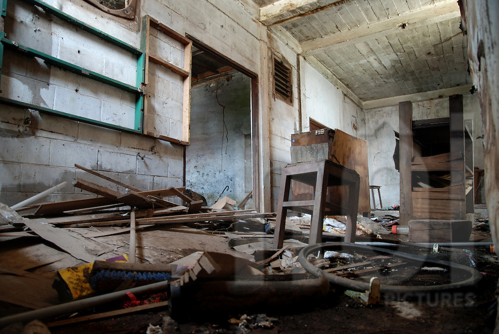 Trash and broken furnitures lay on the ground in the abandoned cinema of Bouasavanh, Vientiane, Laos, Asia
