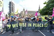 Demonstrators gather at Parliament Square during an Extinction Rebellion climate change protest in central London on Tuesday, Sept 1, 2020. (VXP Photo/ Vudi Xhymshiti)