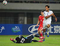 Roque Santa Cruz of Paraguay, right, shoots against China during a friendly football match in Changsha city, central China's Hunan province, 14 October 2014.<br /> <br /> Paraguay's dismal run of form continued as they suffered a 2-1 friendly defeat to China on Tuesday (14 October 2014). The South American nation, who came into the game having won two of their previous 13 fixtures, fell short in their bid to pull off a late comeback at Changsha's Helong Stadium. In contrast to their opponents, China have now lost just two of their last 16 matches as they continue to build towards next year's AFC Asian Cup in Australia.