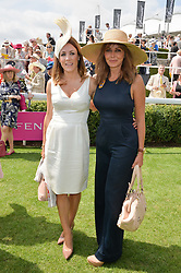 Left to right, NATALIE PINKHAM and CAROL VORDERMAN at the 2014 Glorious Goodwood Racing Festival at Goodwood racecourse, West Sussex on 31st July 2014.