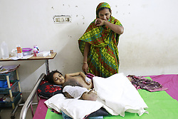 July 13, 2017 - Dhaka, Bangladesh - Muktamoni, a 12-year-old girl from Satkhira, lies on hospital bed at Dhaka Medical College Hospital (DMCH), Dhaka, Bangladesh, July 13, 2017. Muktamoni is suffering from symptoms similar to the 'tree-man disease'. The 12-year-old girl, daughter of a grocery shop owner Ibrahim Hossain of Kamarbaisa village in Sadar upazila, has been passing her days in great suffering due to lack of proper treatment. She always feels unbearable pain in the affected hand that is infested with parasitic worms. Doctors said the rare disease has spread through the entire body of Mukta. She is losing weight but her right hand is becoming heavier. (Credit Image: © Suvra Kanti Das via ZUMA Wire)