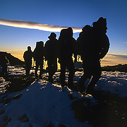 Climbers approach the 19,340 foot summit of Mount Kilimanjaro, Tanzania - the Top of Africa - via the Machame Route.