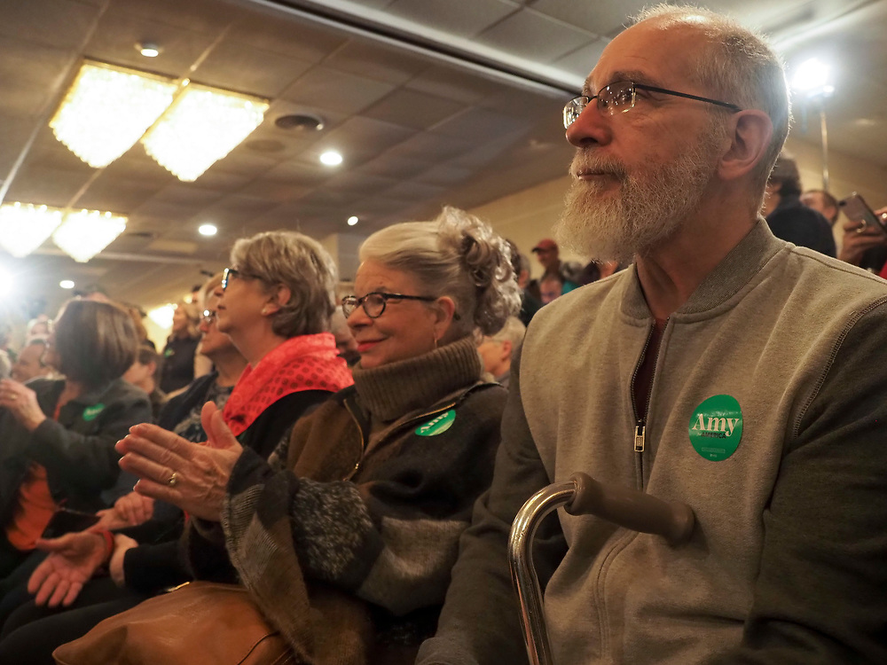 Amy Klobuchar supporters listen attentively during her Cedar Rapids Get Out the Caucus rally.