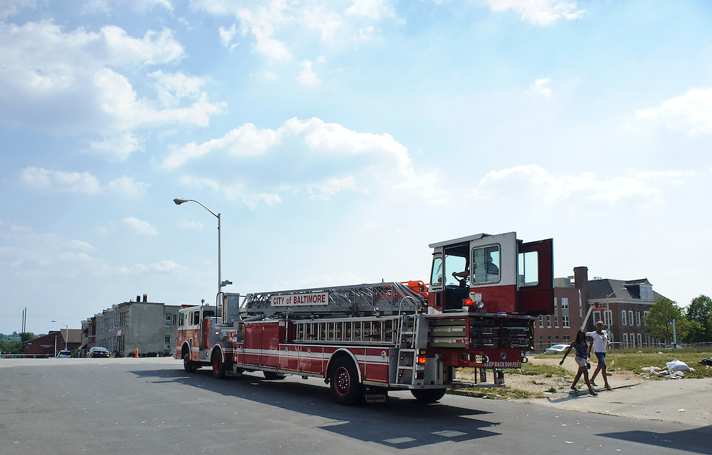 (photo by Matt Roth).Assignment ID: 30127696A.Wednesday, June 20, 2012..Firefighters with Baltimore Truck Company 15 leave for a call Wednesday, June 20, 2012. As of July 1st, the members of Truck Company 15 are slated to be disbanded and reassigned to different companies and the company's truck (not pictured. They're using a reserve truck while their's is being repaired) will be used as a reserve truck...City Councilman William Pete Welch proposes advertisements be allowed on Baltimore City Fire Department vehicles as a way to combat a $48 million budget shortfall, rather than disbanding three companies, including Truck Company 15, which services East Baltimore.