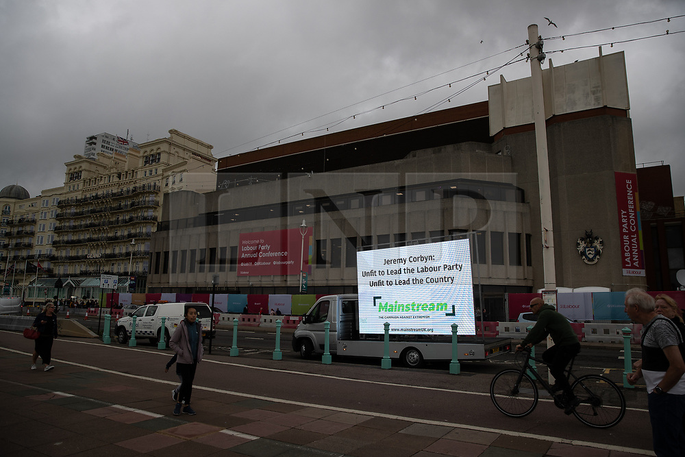 """© Licensed to London News Pictures . 22/09/2019. Brighton, UK. An ad van with the words """" Jeremy Corbyn : unfit to lead the Labour Party , unfit to lead the country """" by a group calling itself """" Mainstream"""" is driven past the conference venue , during the second day of the 2019 Labour Party Conference from the Brighton Centre . Photo credit: Joel Goodman/LNP"""