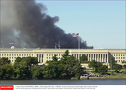 © Steve Deslich/KRT/ABACA. 28540-1. Washington-DC-USA, 11/09/2001. Smoke billows from the Pentagon after a plane crashed into the building partially collapsing the building. Two planes had crashed into the World Trade Center earlier in the morning.  | 28540_01