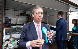 © Licensed to London News Pictures. 18/05/2019. Canvey Island, UK. Brexit Party leader Nigel Farage enjoys a bowl of cockles as he campaigns for the European Elections in Canvey Island, Essex. The European Elections are being held on Thursday 23rd May. Photo credit: Peter Macdiarmid/LNP