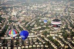 Hot air balloons pass over the city of Bristol during a mass balloon launch from Clifton Downs to mark less than a week to go until the start of the Bristol International Balloon Fiesta.