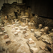 A section of the caldarium of the Roman Baths of Bath in Somerset, United Kingdom. The tiled towers allowed steam to heat a lay of flooring that was placed on top of them.