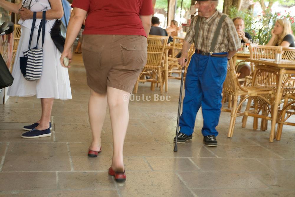 elderly man watching an elderly woman shopping