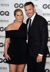 Amy Schumer and Ben Hanisch attending the GQ Men of the Year Awards 2016 at the Tate Modern, London.