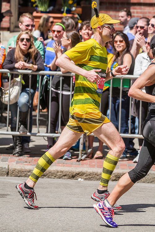 2014 Boston Marathon: runner dressed like a bee heading for the finish line