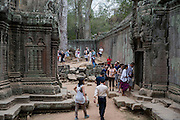 Tourists explore the ancient ruin of the Ta Prohm temple, known as the jungle temple,  in Angkor region Siem Reap Province, Cambodia, South East Asia. UNESCO inscribed Ta Prohm on the World Heritage List in 1992. Today, it is one of the most visited complexes in Cambodia made famous by the Tomb Raider film in 2001.  (photo by Andrew Aitchison / In pictures via Getty Images)