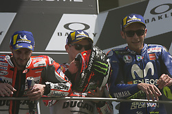 June 3, 2018 - Scarperia, Italy - Ducati Team's Spanish rider Jorge Lorenzo (C) poses on the podium with second placed Ducati's Team rider Italian Andrea Dovizioso (L) and third placed Movistar Yamaha's Italian rider Valentino Rossi after he won the Moto GP Grand Prix at the Mugello race track on June 3, 2018  (Credit Image: © Fabio Averna/NurPhoto via ZUMA Press)